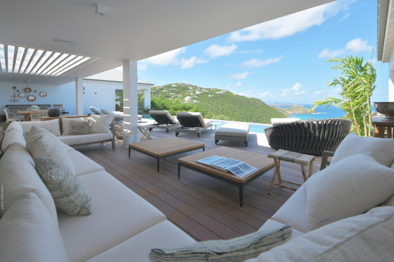Terrace with lounge chairs and seaview
